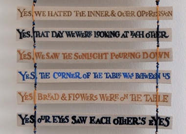 Yes banner (banner with stoneware strips and silk thread - detail), text by Muriel Rukeyser