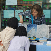 Liz with visitors to the turnthepage2016 artists' book fair. Photo by Frances Bingham.